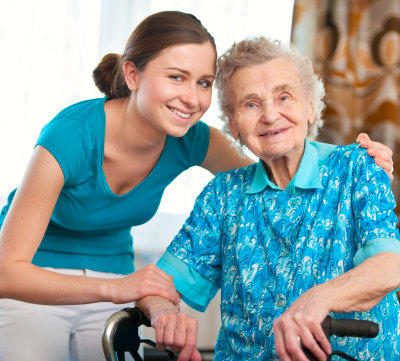 elderly in a wheelchair with her companion