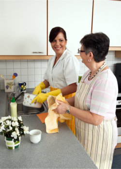 an elderly with her companion in the kitchen