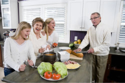 a family in the kitchen preparing food